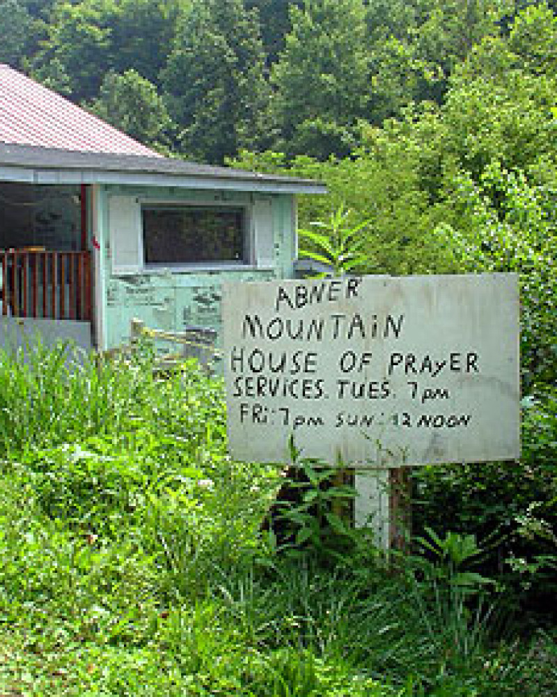 A sign for a small prayer service