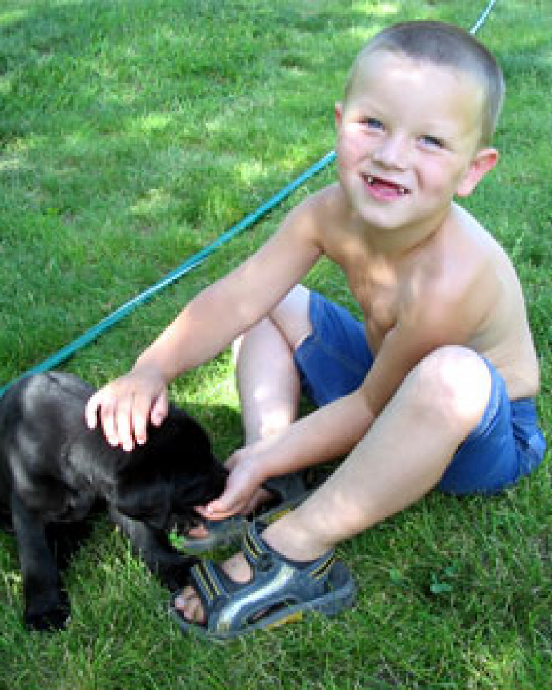 A kid and his dog in Mitchell
