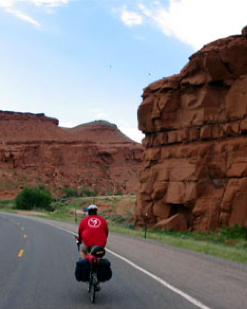 Steve riding through some red rocks