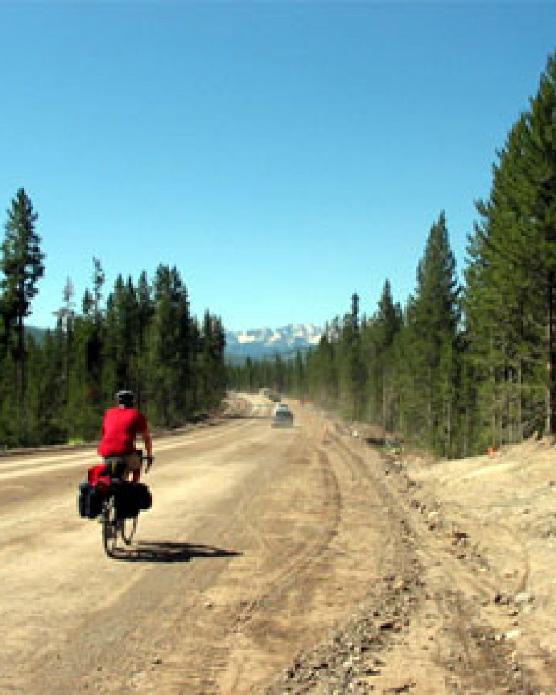 Steve riding out of Yellowstone on a dirt road